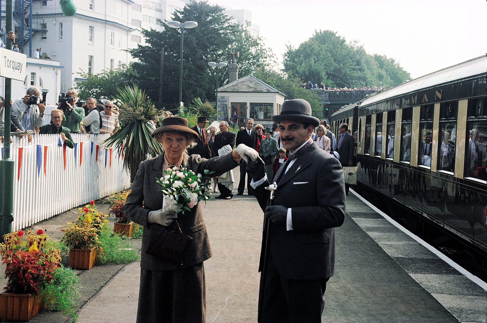 A picture of Joan Hickson and David Suchet as Agatha Christie's  Miss Marple and Hercule Poirot at Torquay station
